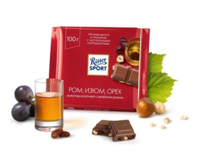 Шоколад Ritter Sport молочный с ямайским ромом, изюмом и орехом лещины 100гр.